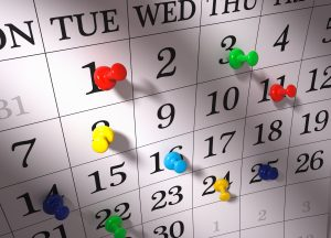 Close up , colorful pushpins on calendar